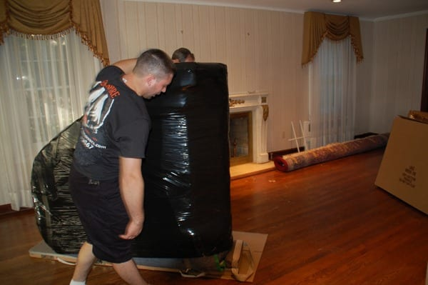 piano moving team at work
