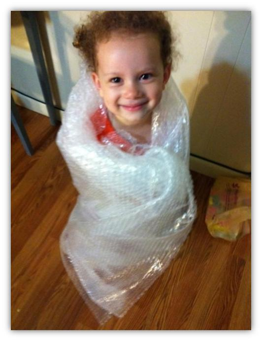 bubble wrapped cute kid funny pic